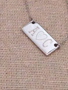 A personal favorite from my Etsy shop https://www.etsy.com/listing/273043856/monogrammed-sterling-silver-half-bar