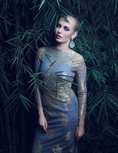 MYTH in Travelite Magazine, WInter 2013  *L/S Powder Blue Tulle Dress with Gold Lace Accent by Joel Escober at MYTH.  - Photography by Paelo Pedrajas - Styling by James Scott