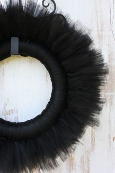 How to make a tulle wreath.  (I'm thinking many colors and occasions.  Also graduations as party decor in school colors and grad keeps it?)