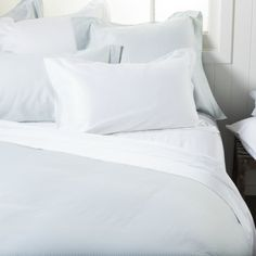 These gorgeous quilt covers feature sky blue printing against the crisp white fabric