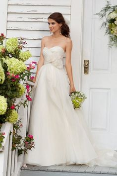 This Watters gown is a favorite of mine. The silk organza  overlay and flower details are so elegant.