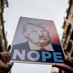 """A demonstrator holds a sign of President Donald Trump with the word """"NOPE,"""" as they make their way during the Women's March in Barcelona, Spain. The event on Saturday originated in Washington, DC, but soon spread to be a global march calling on all concerned citizens to stand up for equality, diversity and inclusion and for women's rights to be recognized around the world as human rights. ( by David Ramos/Getty Images) #Trump #womensmarch  via ✨ @padgram ✨(http://dl.padgram.com)"""
