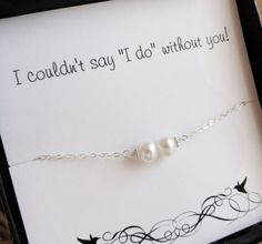 Pearl bracelets, a bridesmaid gift they can wear to the wedding.