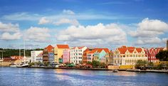 December 9th - Willemstad, Curacao, Lesser Antilles * Dutch colonial buildings are a colorful backdrop for Willenstad, a cultured and sophisticated city on the sunny Caribbean island of Curacao.  Its cafes, shops, restaurants, and Museum Kura Hulanda all conspire to lure vacationers away from the island's snorkeling spots and beaches.