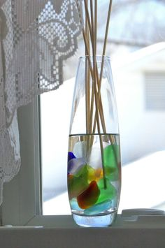 Put your most colorful pieces of sea glass in a glass container and add clear fragrance oil and diffuser reeds. The oil brings out the color of the sea glass and hides imperfections, and your room will be filled with fragrance!