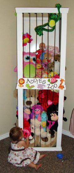 """Stuffed animal case with """"bungee"""" bars....great way to keep all those stuffed animals in the some sort of order! by bernadette"""