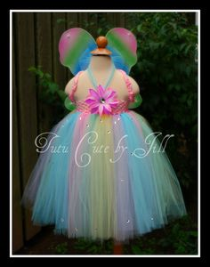 Pastel rainbow tutu dress...  except i don't want pastel, and it needs to be adult-sized hah