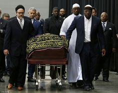 The three-time world champion boxer's body was wheeled into Freedom Hall by officials for Thursday's Jenazah service