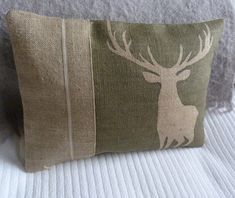 hand printed soft olive stag cushion. $62.00, via Etsy.