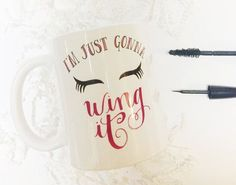 I'm Just Gonna Wing It Makeup Cosmetics Funny Mascara Eyeliner Girly Humor Coffee Java Ceramic Mug Cup by TheScribbleStudio on Etsy (null)