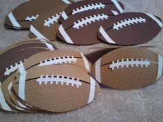 Handmade football birthday party invitations.  I cut them from Cricut and ran through the big shot for texture.