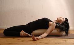 Suzanne in supported Supta Virasana, a restorative yoga pose at yogagarage Zurich.