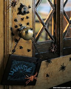 "Spider Welcome Sign    The front-door welcome sign is ""spun"" with chalk on a crafts-store blackboard in a ready-made frame; sticking plastic spiders onto woodwork with weather-stripping tack prevents damage to the finish and allows for easy removal."