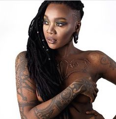 I just love EVERYTHING about this photo! Locs... Makeup... Body Art... <3