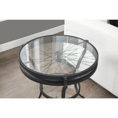 Compact design and unique style come together in the Hammered Black Accent Table. Featuring a sophisticated black finish and enough surface area to display your favorite pieces, this table is sure to complement a variety of different decors.