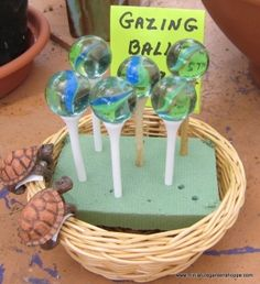 "Miniature Garden Inspiration Gallery - A golf tee topped with a ""cat's eye"" marble becomes a gazing ball on a stand for a miniature fairy garden. Mini Fairy Garden, Fairy Garden Houses, Gnome Garden, Fairies Garden, Fairy Gardening, Indoor Gardening, Organic Gardening, Gardening Quotes, Flowers Garden"