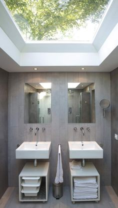 Let the light into a small bathroom by installing some roof windows, and how beautiful that you can see the trees too!