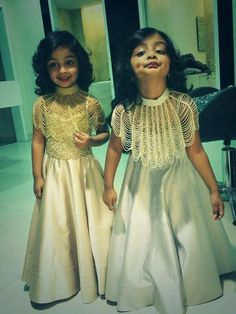 Cute twins and the gown......... .