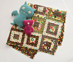 This easy-to-make quilt alternates chocolate- and vanilla-color backgrounds with some jelly bean-like polka dot prints for a yummy throw!