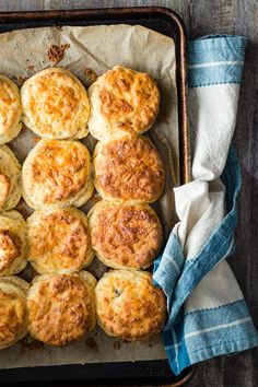 Light and flaky cheddar biscuits with chipotle cheddar and fresh basil. These savory biscuits are so easy to make and the perfect side for any comfort dish!