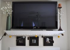 Chic and Modern TV Wall Maounting Ideas #TVWallIdeas #TVMount #Wall #Modern #TV  - Shelf under wall mounted TV.
