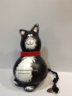 This kitty is fashioned after my own Tuxedo cat. He is hand painted and has a yarn tail with a little heart at the end that says Hand made