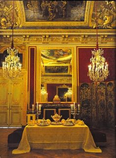 Dining room of the King by candlelight; Versailles.