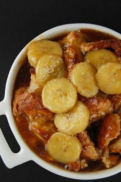 Bananas Foster Bread Pudding...3 eggs, 2 egg yolks, ¼ tsp nutmeg, 1 tsp cinnamon, 1 c very ripe bananas, pureed, 1 tsp vanilla extract,  1 c sugar, ½ c light brown sugar, firmly packed, 1 ¾ c heavy whipping cream, 1 large French bread loaf (5- 6 c torn up)...