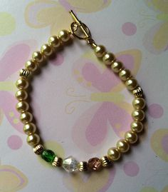 Mother's Bracelet  made with 6mm Almond color Pearls, Czech & Brilliance crystals with Gold accent. Birthstones Nov, April & May. Sold
