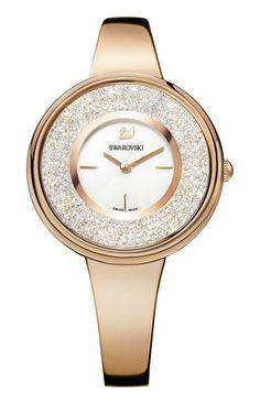 Swarovski Dameshorloge 'Pure' rosékleurig 5269250.  Voeg elke dag een beetje sprankeling toe met dit elegant vormgegeven horloge uit de Swarovskicollectie. Het gebruik van swarovskikristallen en de ronde kast geven dit horloge een klassieke en elegante uitstraling. De rosékleurige kast heeft op de wijzerplaat de beroemde Swarovski-zwaan en index op 3,6,en 9 uur. #rosegold #swissmade #kristal #trendy #chique https://www.timefortrends.nl/horloges/swarovski.html