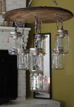 Whiskey Barrel Mason Jar Chandelier - This one of a kind chandelier is handmade using 7 quart-size mason jars with vintage Edison radio bulbs and a used Kentucky bourbon whiskey barrel head. (Which still faintly smells like bourbon even after I restored it!) Made in Nashville, TN by an average musician.
