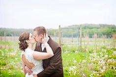 bride and groom kissing   mayowood stone barn country wedding   photo: angelicjewelphotography.com