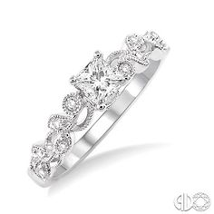 Princess cut diamond ring with vine inspired band. Love this so much!