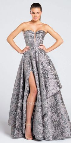 A-Line Strapless Jacquard Prom Dress By Ellie Wilde for Mon Cheri. The luxurious details include a strapless sweetheart plunging neckline, fitted jacquard bodice with beaded band at empire waist, and asymmetrical tiered ball gown skirt with thigh high side slit. #edressme