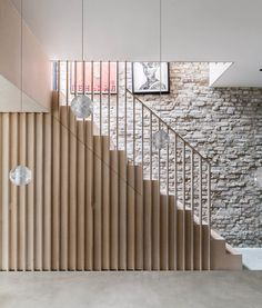 A plywood staircase with vertical slats leads to the first floor in a house in Calais Street, Camberwell, south east London designed by architect David Money. Staircase Storage, Staircase Railings, Staircase Design, Stairways, Balustrade Design, Banisters, Grand Designs Magazine, Flur Design, Sliding Pocket Doors