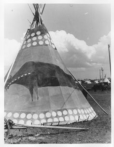 Blackfoot tipi - 1942 with traditional painted lodge design. JE