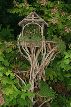 Fairy Garden - wonderful idea - grapevines trained to form fairy houses in the sky . would take some time, but this is intriguing! Magic Garden, Dream Garden, Bird Cages, Bird Feeders, Fairy Garden Houses, Fairy Gardens, Miniature Gardens, Gnome House, Fairy Land