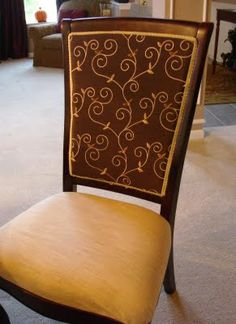 We have cream-colored chairs in this type of style, and had no idea how to do reupholster the back (the color is REALLY not working with 4 kids!)  SO glad I found this tutorial!
