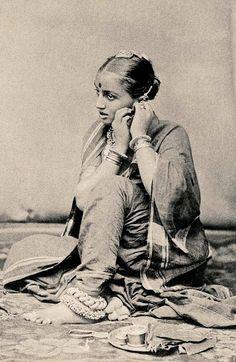 Girl putting on earrings. http://vintageindia.tumblr.com/image/825627998