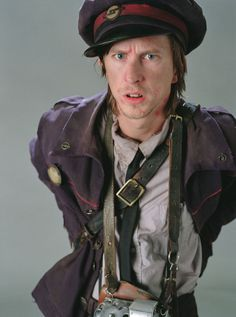 Lee Ingleby plays Stan Shunpike. Stan was a wizard and was the conductor and helper of the Knight Bus. In 1996, he was arrested and sent to Azkaban for being a Death Eater when he was overheard claiming to have inside information about the organisation, although in all likelihood, he was only fooling around.