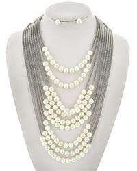 Layered silver pearl necklace set.