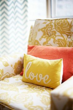 Yellow love pillow with coral on yellow patterned chair. Love this with the blue chevron curtains! So bright and cheerful