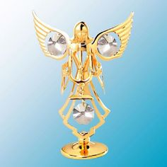 Angel With Candle Figurine - Swarovski Crystal Elements  --  Our  golden Angel with her candelabra is fashioned in brilliant 24k gold plated finish and accented with clear crystal Swarovski elements that will shine brilliantly when exposed to light. You will appreciate the fine details of design and craftsmanship.