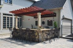 someday... outdoor kitchen bar seating with pergola