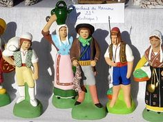 "Santons de Provence  - Santons (Provençal: ""santoun,"" or ""little saint"") are small (2.5-15 cm.) hand-painted, terracotta nativity scene figurines produced in the Provence region of southeastern France. In a traditional Provençal crèche, there are 55 individual figures representing various characters from Provençal village life such as the scissors grinder, the fishwife, the blind man, and the chestnut seller."