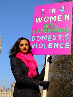Alesha Dixon Holding A Banner Proclaiming That 1 in 4 Women Will Experience Domestic Violence  #Stop #Domestic #Violence