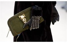 Is that a fox head on this oversized Burberry clutch? We kind of like it...