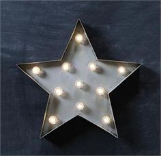 """Brighten your farmhouse and celebrate country style with our Rustic Metal Star Light. Inspired by rustic barn stars that capture the spirit of country, this battery operated LED light creates eye-catching wall art with star quality. Requires three AA batteries. 15""""W x 14""""H"""