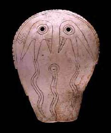 Late Mississippian culture engraved whelk shell gorget maskette with weeping eye motif