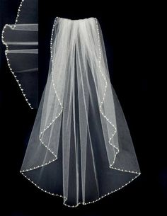 Trios of pearls and clear seed beads embellish the edge of this waist length wedding veil. Perfect pearls for your wedding! It is 30 inches long and 72 inches wide, on a four inch metal comb.